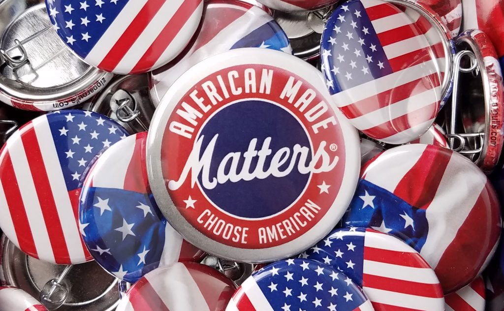 "Buttons with the American flag, with a centered button saying ""American made matters, choose American""."